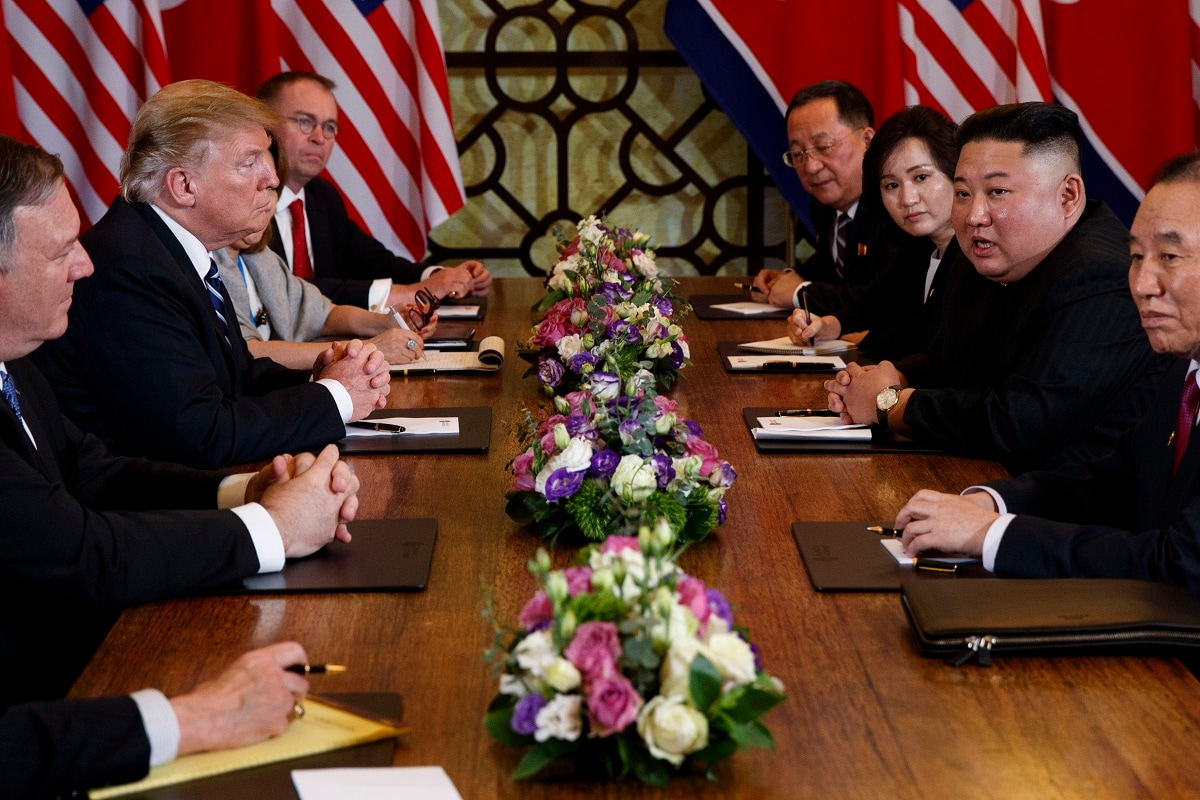 President Donald Trump speaks during a meeting with North Korean leader Kim Jong Un Thursday in Hanoi. At front right is Kim Yong Chol, a North Korean senior ruling party official and former intelligence chief. At left is Secretary of State Mike Pompeo, second from left. (AP Photo/ Evan Vucci)