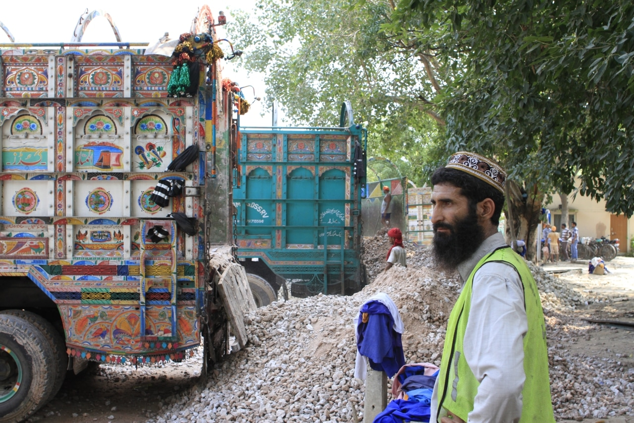 Pakistani truck driver at a cement offloading site in India.