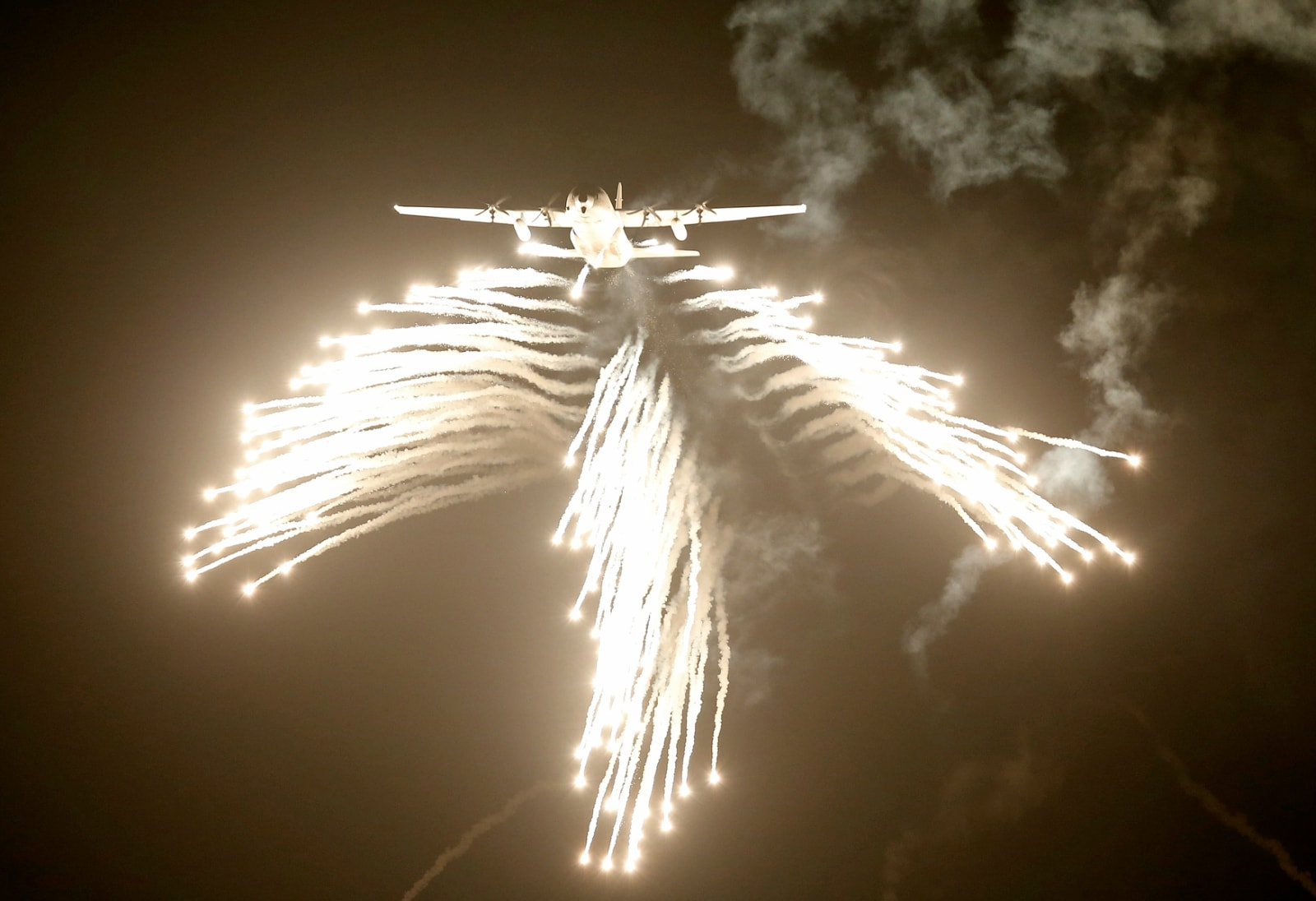 A US-made C-130J Hercules aircraft of the Indian Air Force (IAF) fires flares during