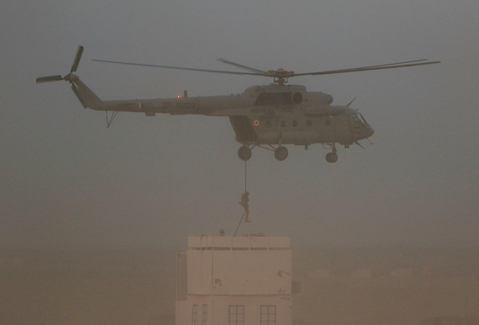 An Indian Air Force (IAF) Garud Commando performs during
