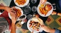 From hunter-gatherers to super consumers: We love to sit and order food