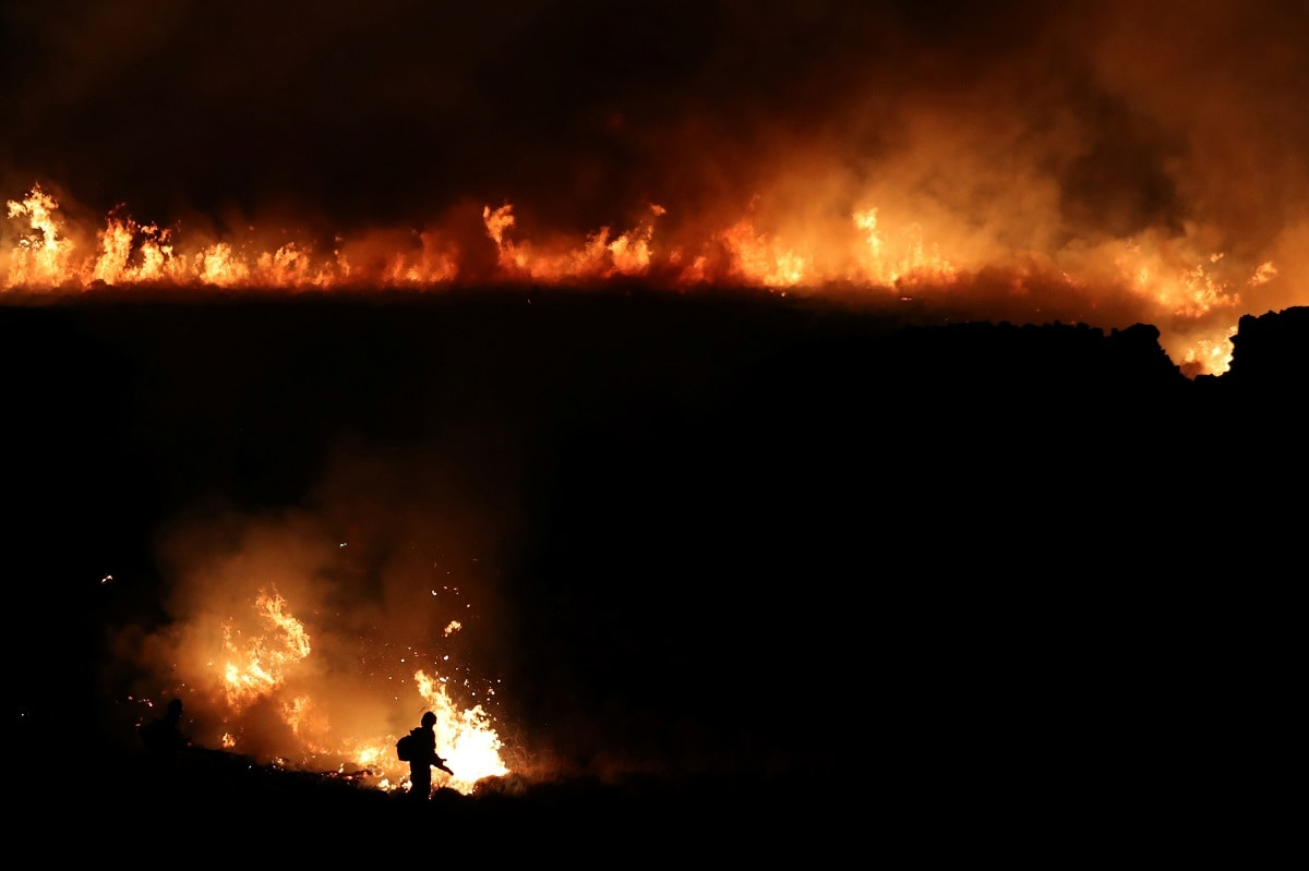 Fire rages around Saddleworth Moor near the town of Diggle, Britain. (REUTERS/Jon Super)