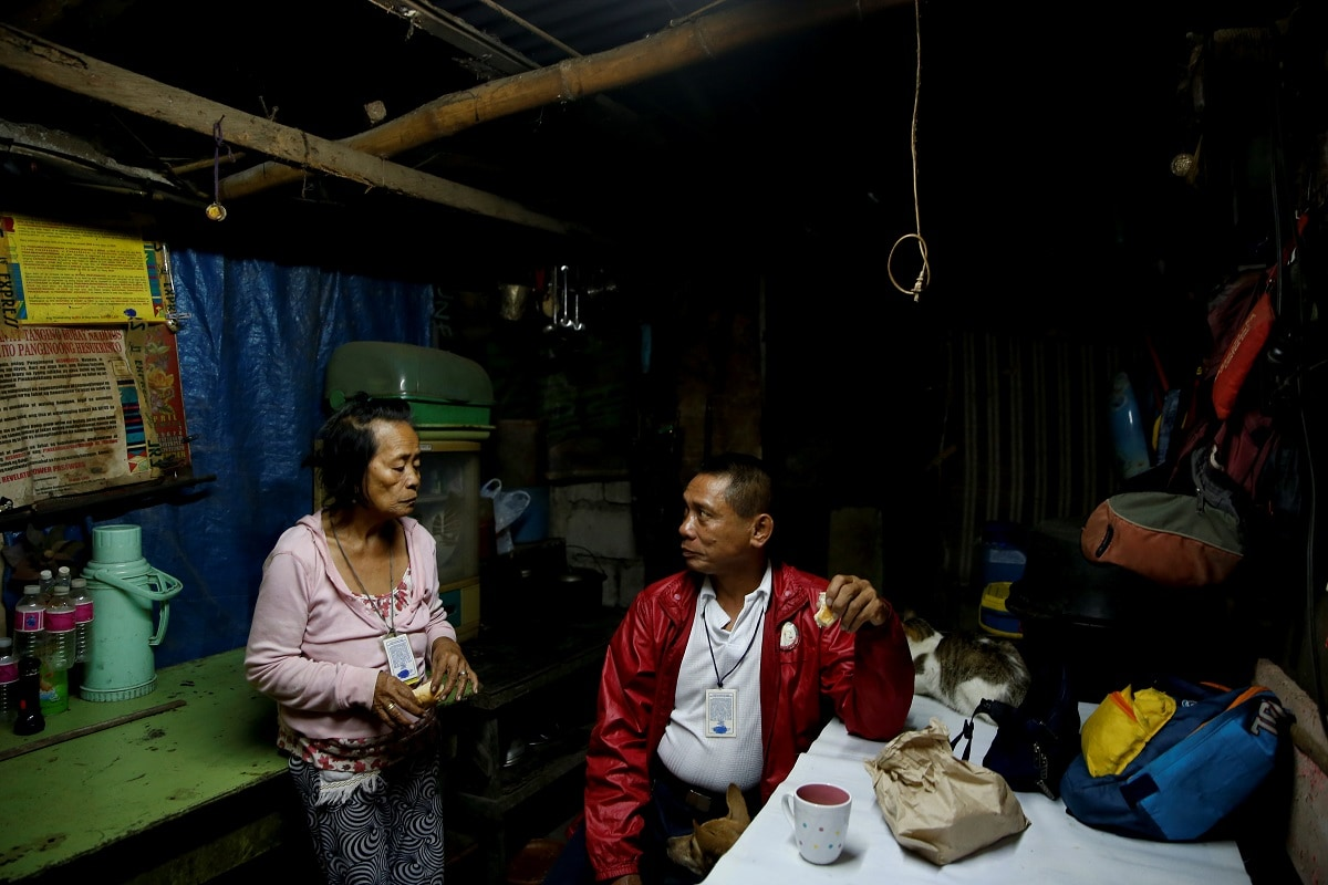 Alejandro Galasao, 58, street sweeper, eats breakfast with his wife in their home in San Jose Del Monte City, Bulacan province, Philippines, November 15, 2018. Galasao wakes up between 1:00-2:00 am every day to prepare his food and clothes before going to work. (REUTERS/Eloisa Lopez)