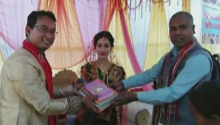 In this Assam wedding, guests donate old clothes and books, take