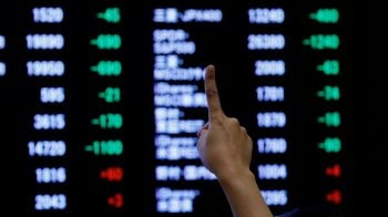 Asian shares gain on better Sino-US trade tone, oil climbs