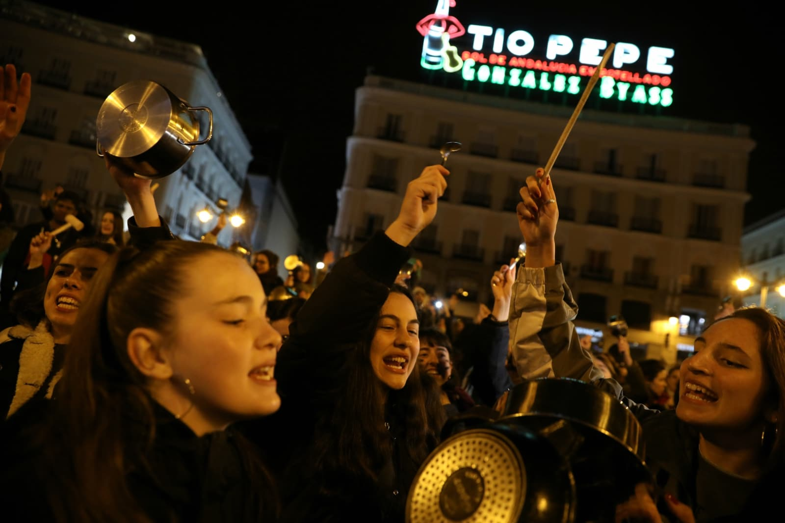 Women bang pots and pans during a protest at the start of a nationwide feminist strike on International Women's Day at Puerta del Sol Square in Madrid, Spain. (REUTERS/Susana Vera)