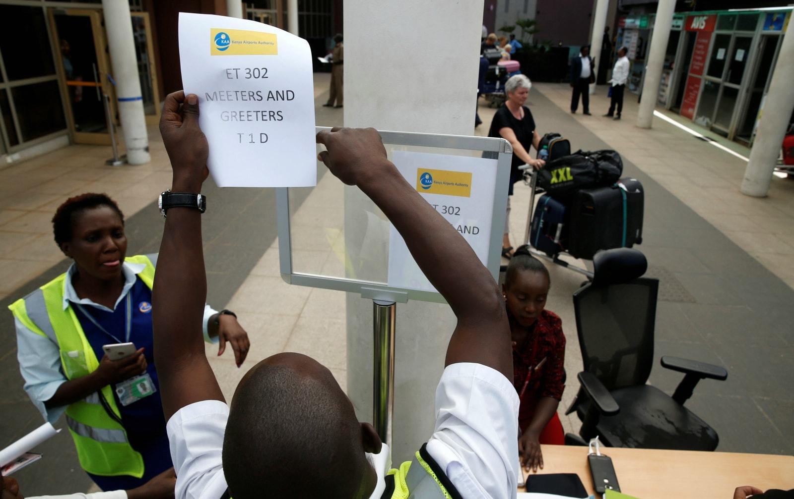 Kenya Airports Authority (KAA) workers hang an information notice of Ethiopian Airlines Flight ET 302, at the Jomo Kenyatta International Airport (JKIA) in Nairobi, Kenya March 10, 2019. REUTERS/Baz Ratner