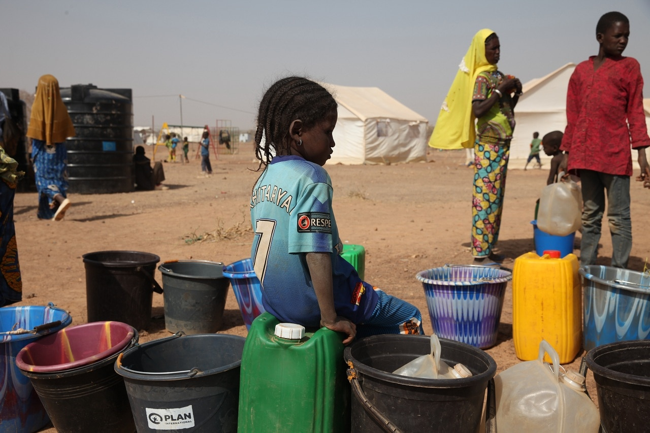A girl waits in line for the water pump at a camp for internally displaced persons in Barsalogho, Burkina Faso, March 4, 2019. (Reuters)