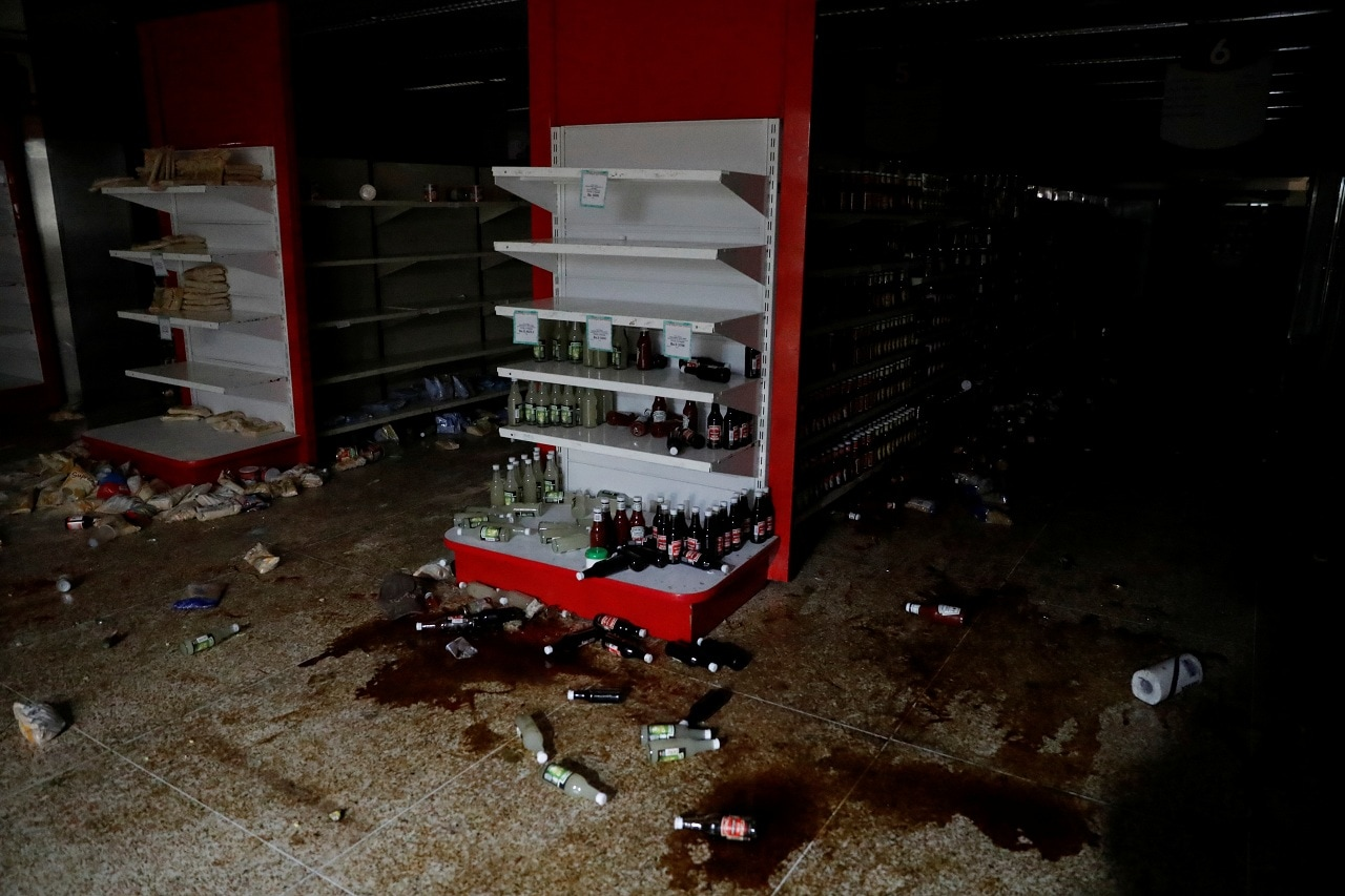 Damage is seen in a supermarket after it was looted during an ongoing blackout in Caracas, Venezuela March 10, 2019. (Reuters)
