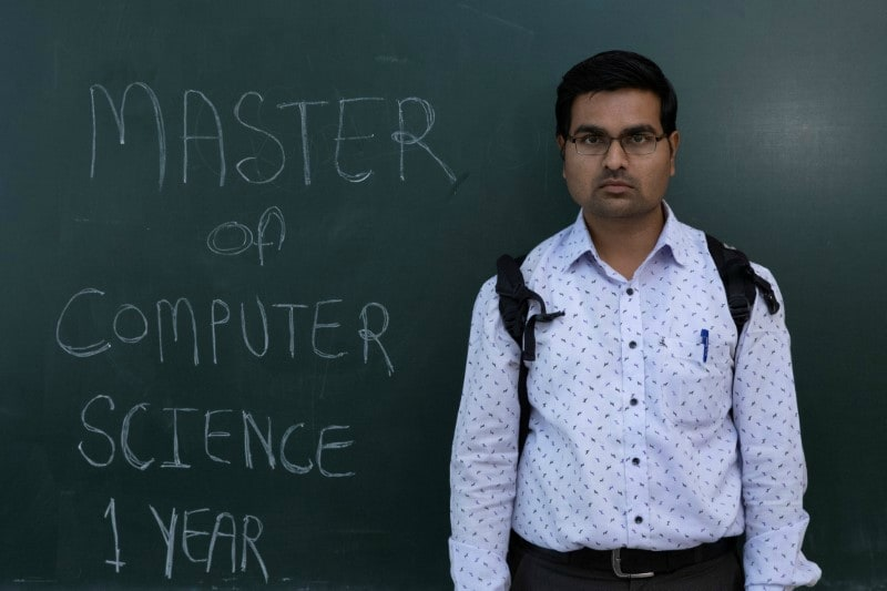 Pankaj Kumbhakarn, a 27-year-old Master of Computer Science (MCS) graduate who has been unemployed for one year poses during a job fair in Chinchwad, February 7, 2019.