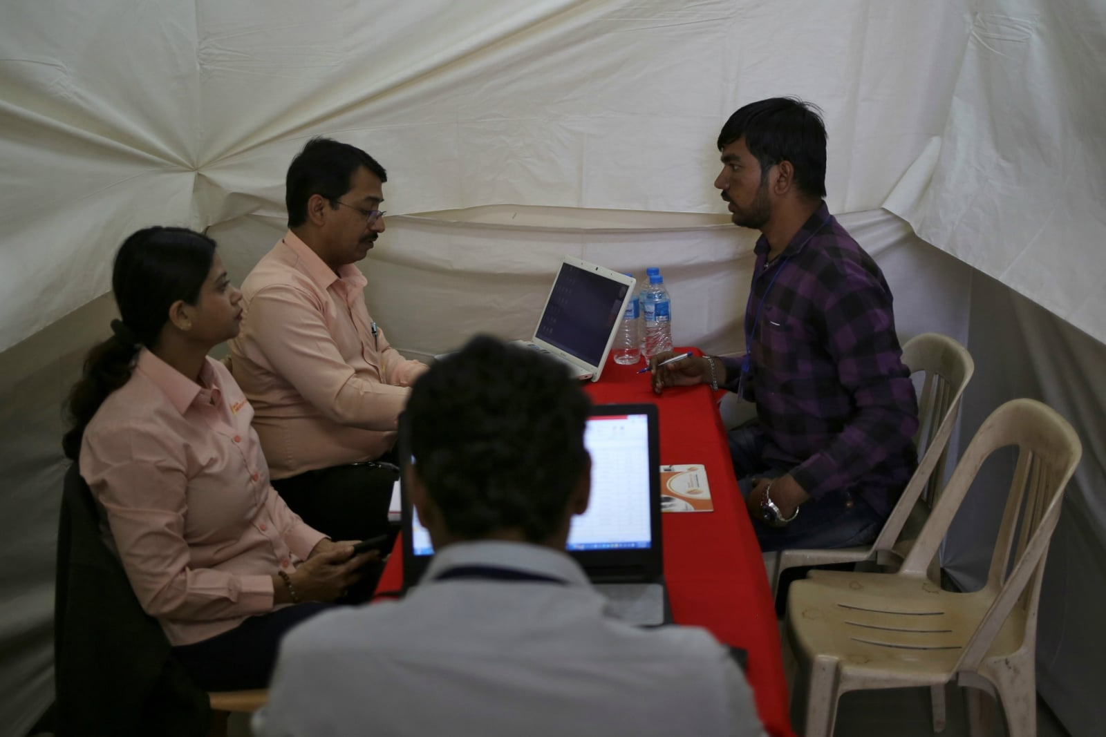 A job seeker is interviewed by human resource managers at a job fair in Chinchwad, February 7, 2019. REUTERS/Danish Siddiqui/Files