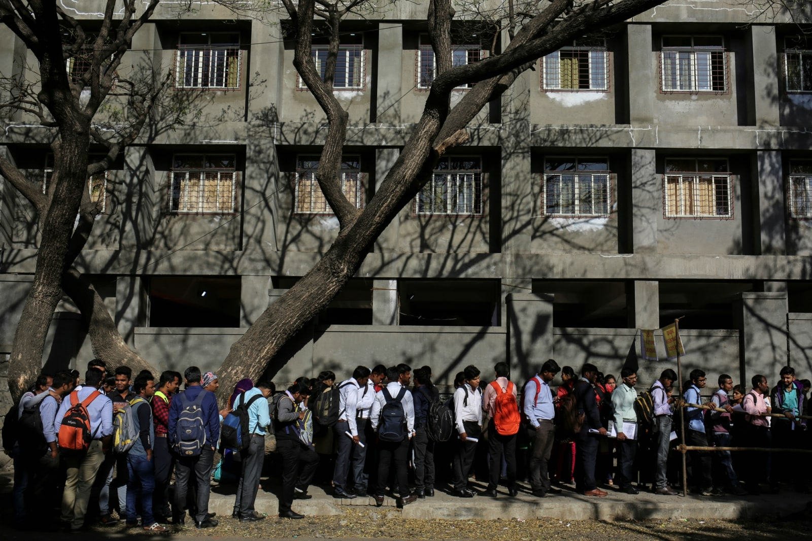 Job seekers line up outside the venue of a job fair in Chinchwad, February 7, 2019. REUTERS/Danish Siddiqui/Files