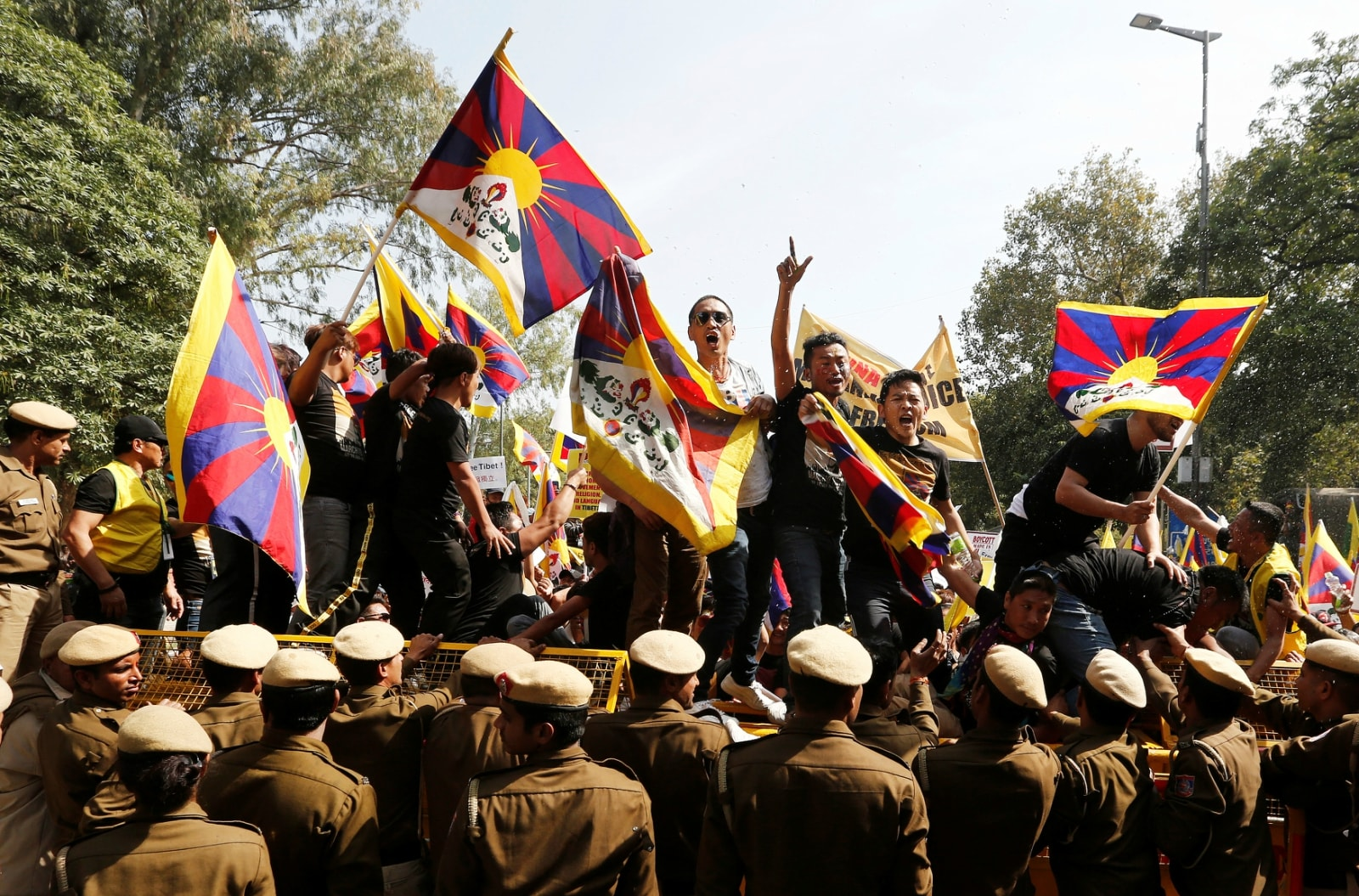 Tibetans shout slogans as they stand on a police barricade during a protest held to mark the 60th anniversary of the Tibetan uprising against Chinese rule, outside the Chinese embassy in New Delhi, India March 12, 2019. REUTERS/Adnan Abidi