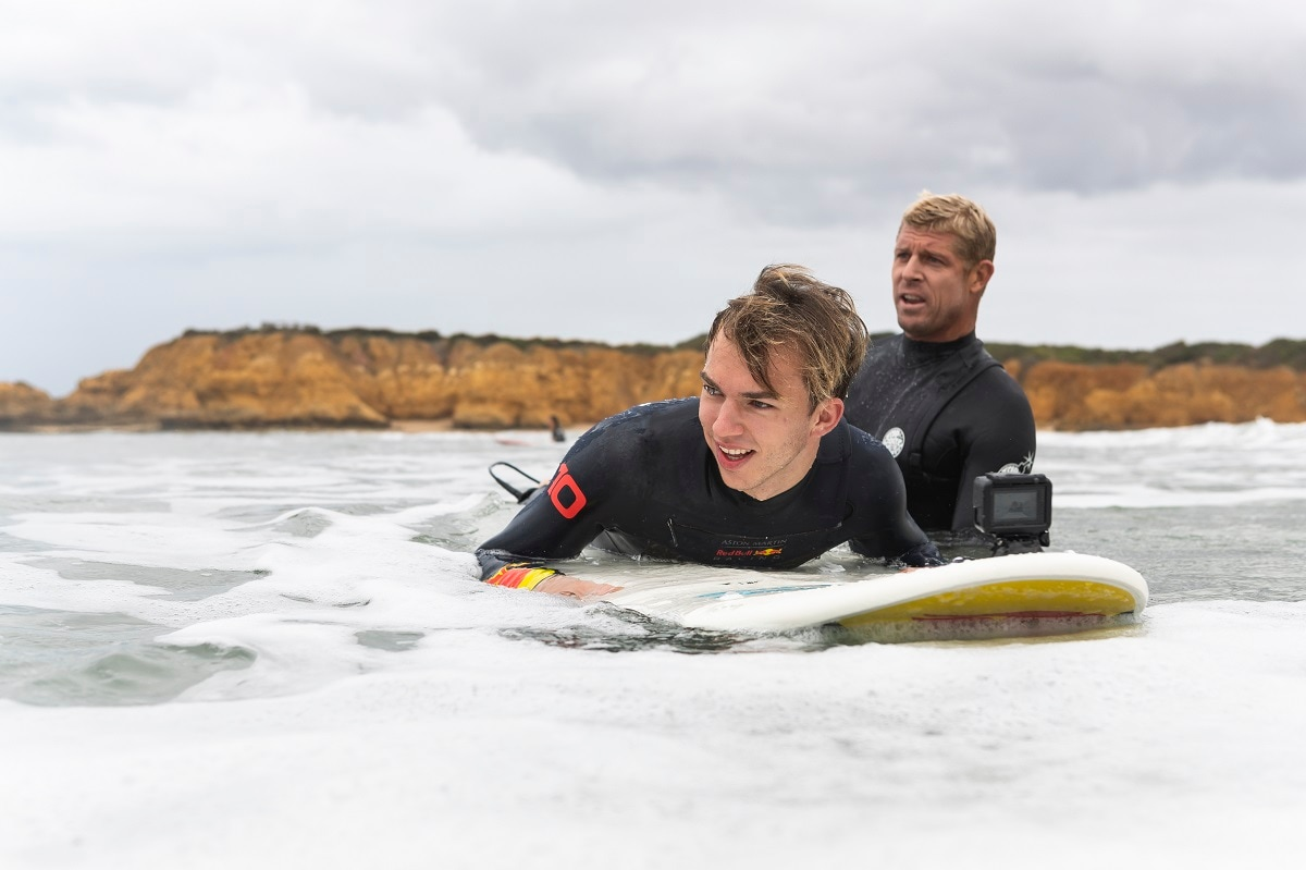 Three-time surfing world champion Mick Fanning takes F1 driver Pierre Gasly surfing. (Andy Green/Red Bull Content Pool)