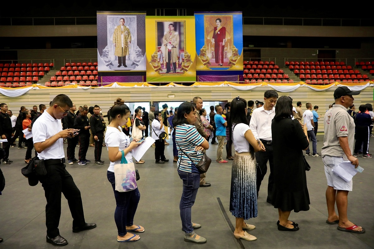People line up for their early vote for the upcoming Thai election. (REUTERS/Soe Zeya Tun)