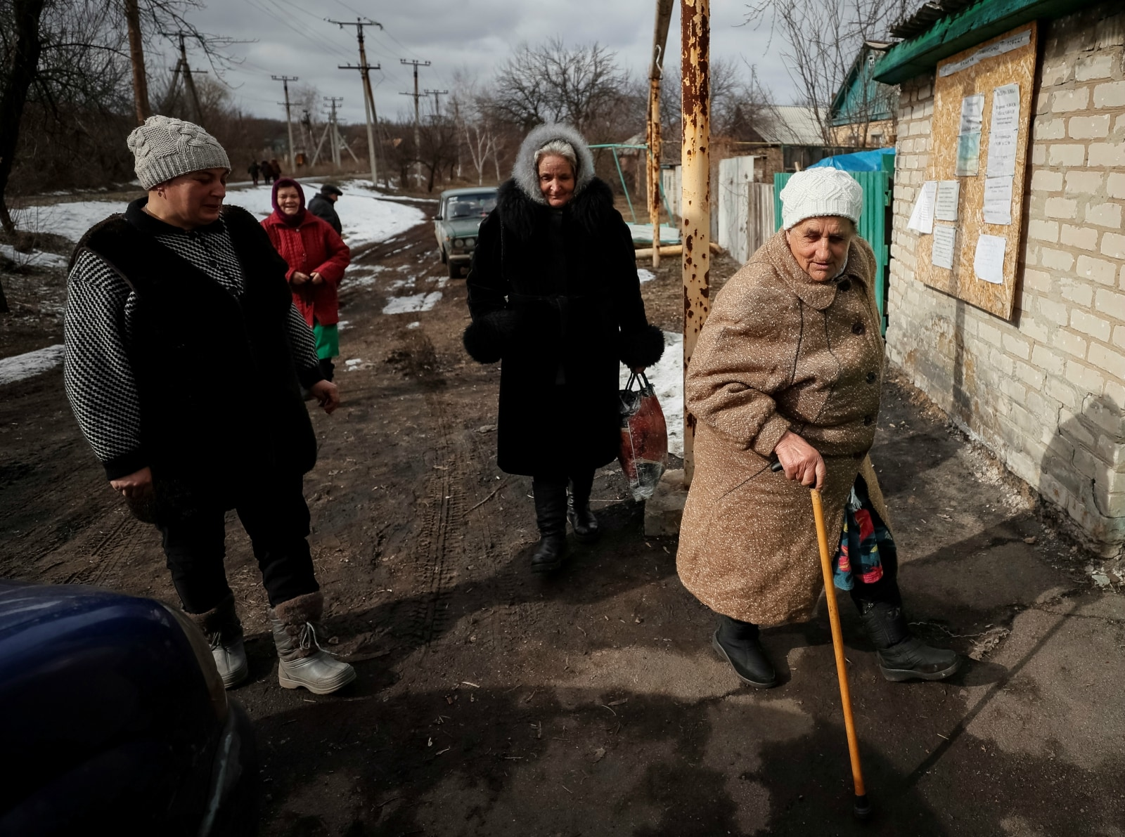 Local resident Galina Soboleva (C) walks along a road with other women in the village of Zaitseve, Ukraine, February 22, 2019. There are not many people left in Zaitseve, a village on the front line that divides Ukraine, but voters like Soboleva want just one thing from this month's presidential election.