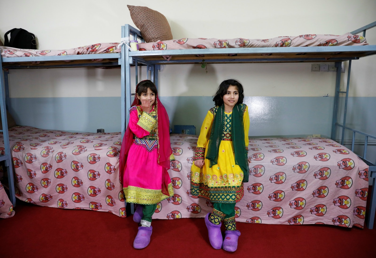 Afghan girls sit on a bed at an Afghan Child Education and Care Organization center (AFCECO) in Kabul, Afghanistan March 3, 2019. REUTERS/Mohammad Ismail