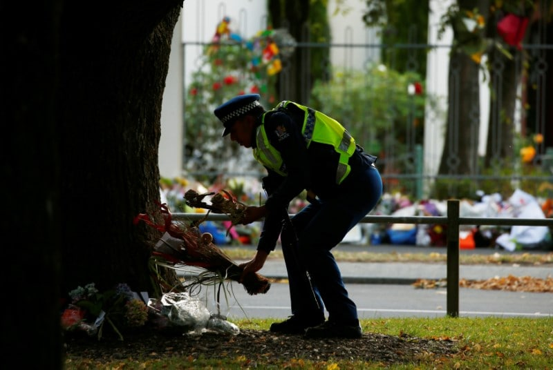 A policeman lays flowers outside of the Al Noor Mosque in Christchurch, New Zealand March 21, 2019. REUTERS/Edgar Su