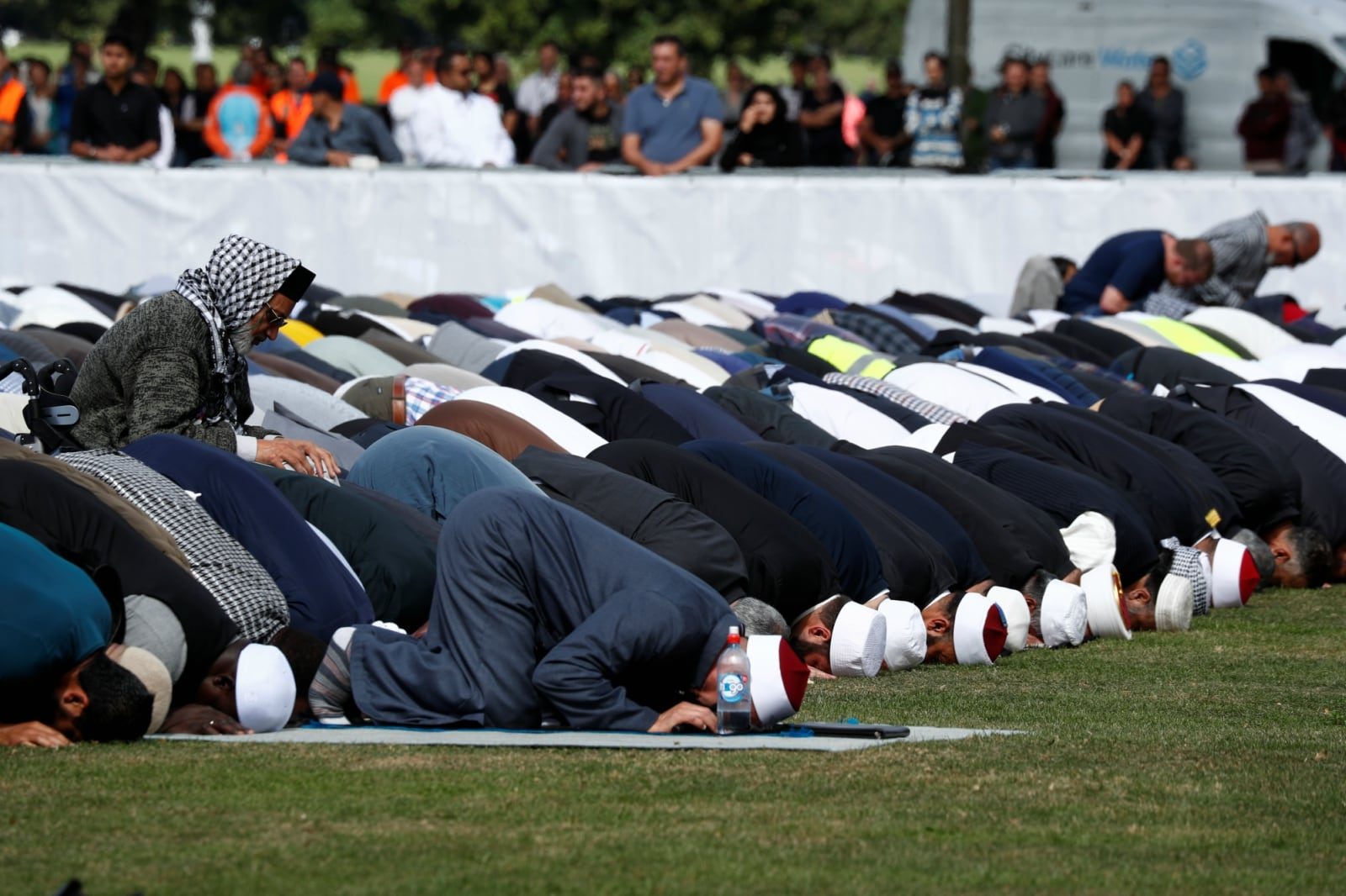 People perform the Friday prayers at Hagley Park outside Al-Noor mosque in Christchurch, New Zealand March 22, 2019. REUTERS/Edgar Su