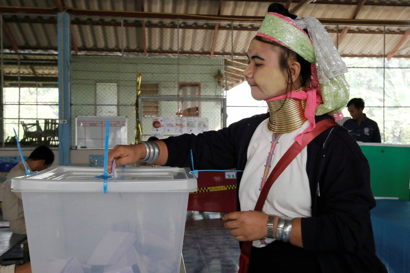 An ethnic Kayan woman, also known as a long neck villager casts her vote for the general election in Mae Hong Son, Thailand, March 24, 2019. REUTERS/Ann Wang