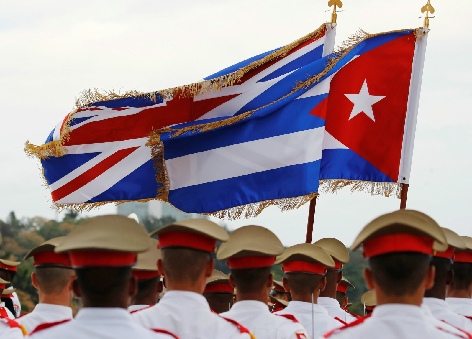 The Union Flag and Cuba's national flag flutter above a guard of honour as Britain's Prince Charles and Camilla, Duchess of Cornwall, arrive in Havana, Cuba, March 24, 2019. REUTERS/Phil Noble
