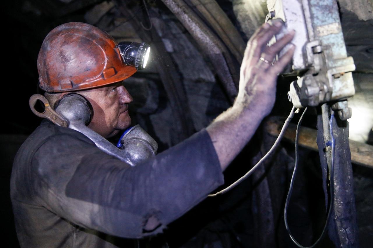 Mining engineer Volodymyr Matyukh works inside the Novovolynska-9 coal mine in Novovolynsk, Ukraine August 2, 2018. Picture taken August 2, 2018.(Reuters)