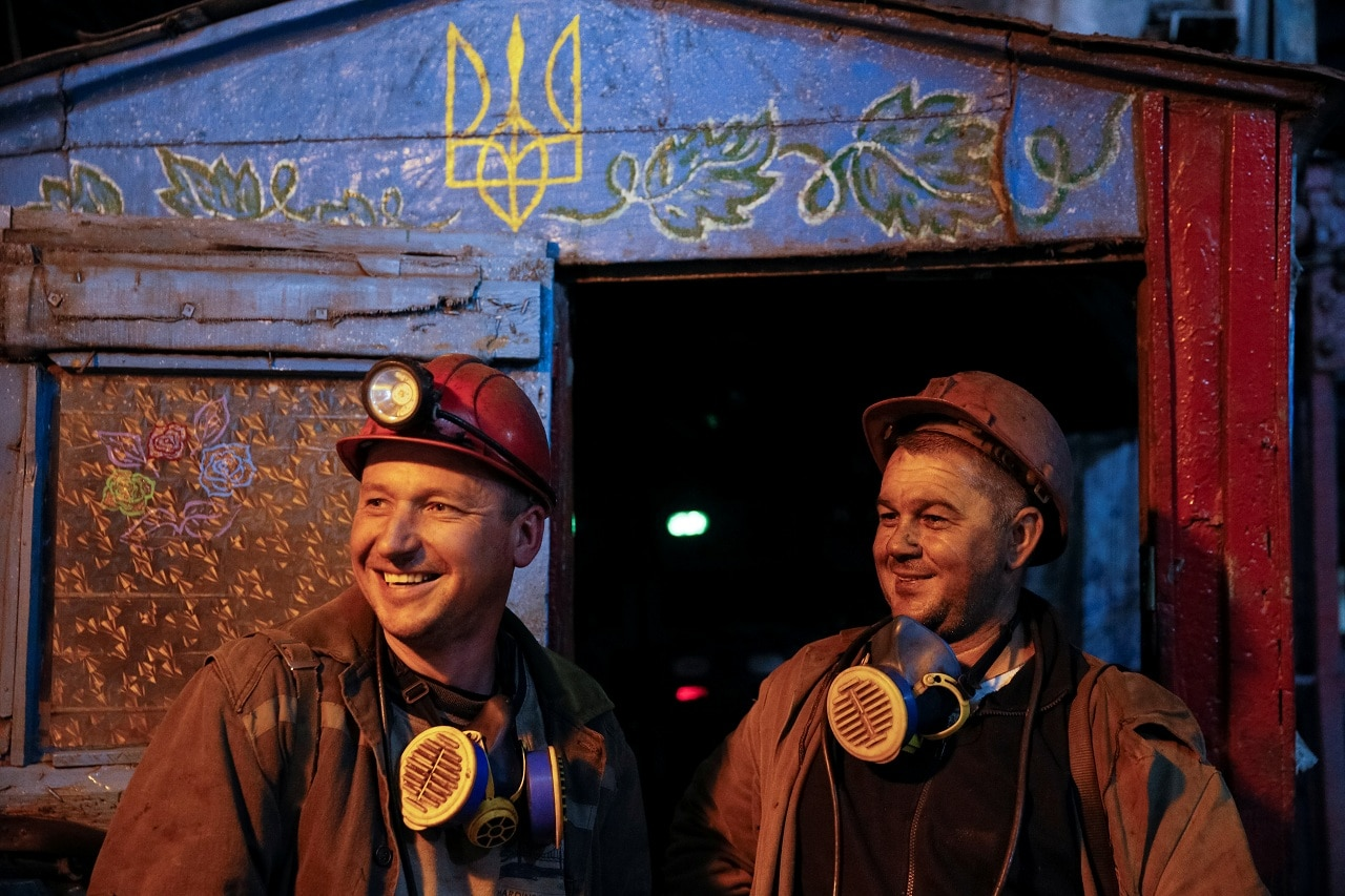 Miners smile while they speak with Reuters after the end of their shift at the Novovolynska-9 coal mine in Novovolynsk, Ukraine August 2, 2018. Picture taken August 2, 2018. (Reuters)