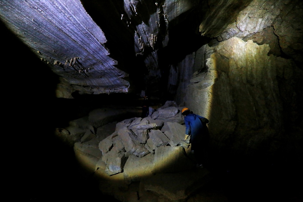 A woman walks inside the Malham Cave. (REUTERS/Nir Elias)