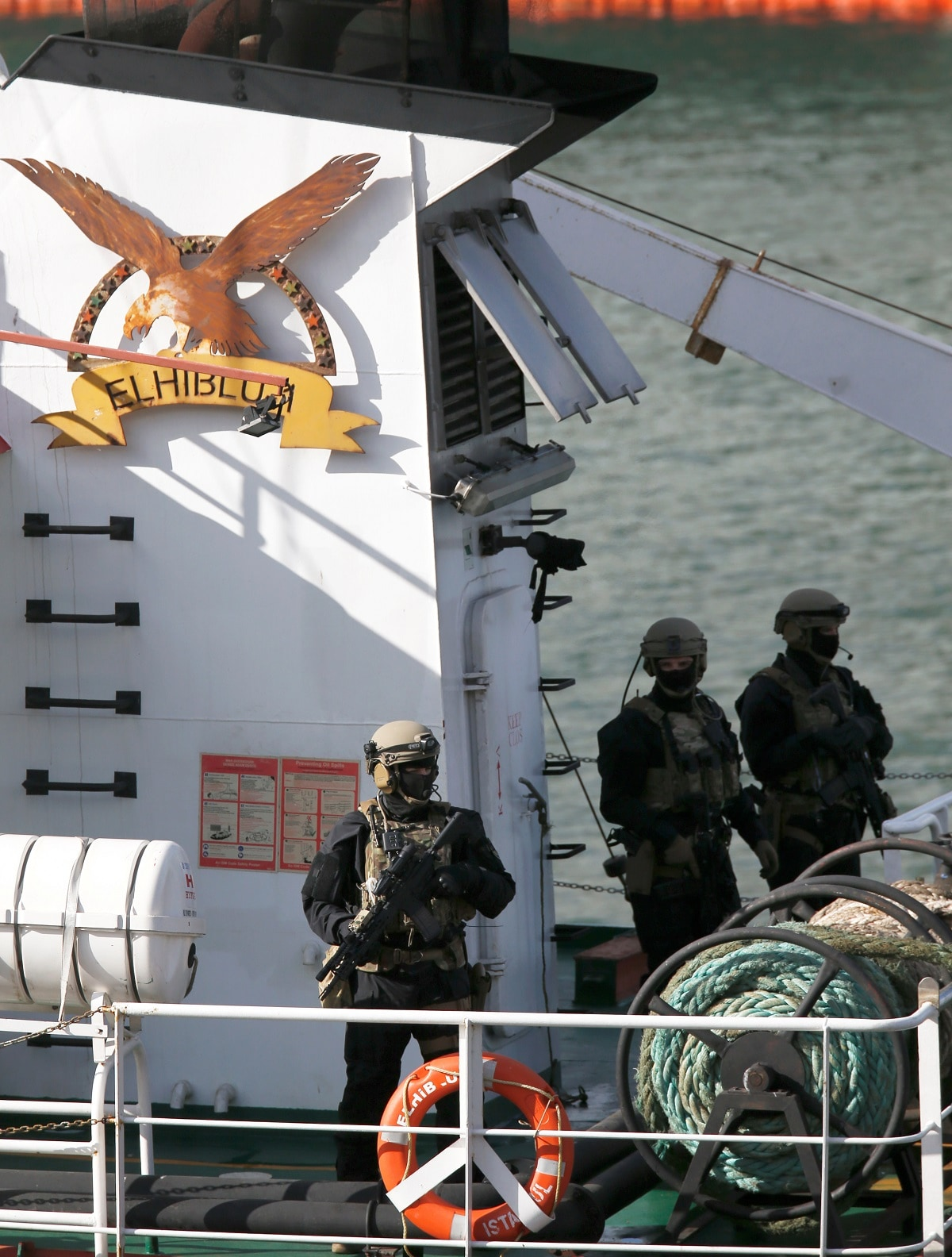 Maltese special forces soldiers are seen on the merchant ship Elhiblu 1 after it arrived in Senglea in Valletta's Grand Harbour. (REUTERS/Darrin Zammit Lupi)