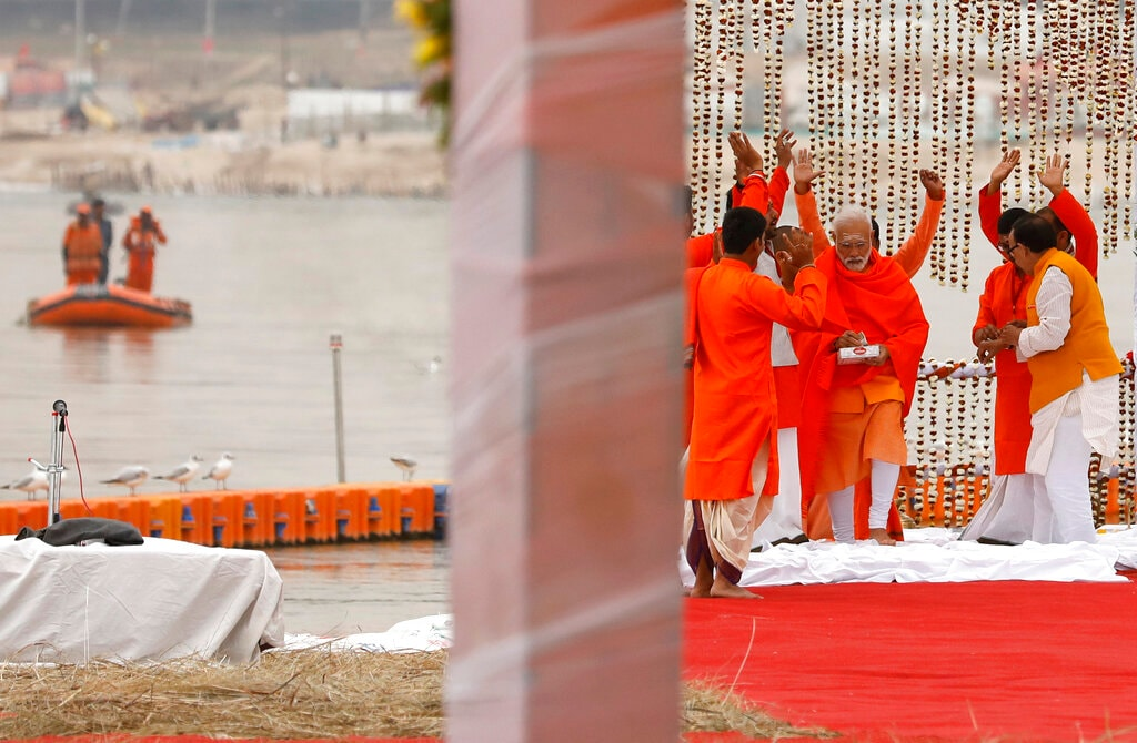 Prime Minister Narendra Modi, returns after taking a holy dip at Sangam, the confluence of the Rivers Ganges, Yamuna and mythical Saraswati, during Kumbh festival, in Allahabad, India, Sunday, February 24, 2019. (AP Photo/ Rajesh Kumar Singh)