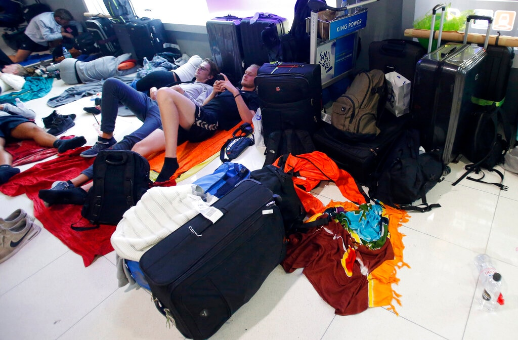 Danish students sleep overnight at Suvarnabhumi Airport in Bangkok, Thailand Thursday, February 28, 2019. In Bangkok, an important and busy hub for transcontinental flights, thousands of travellers were stranded. (AP Photo/Sakchai Lalit)