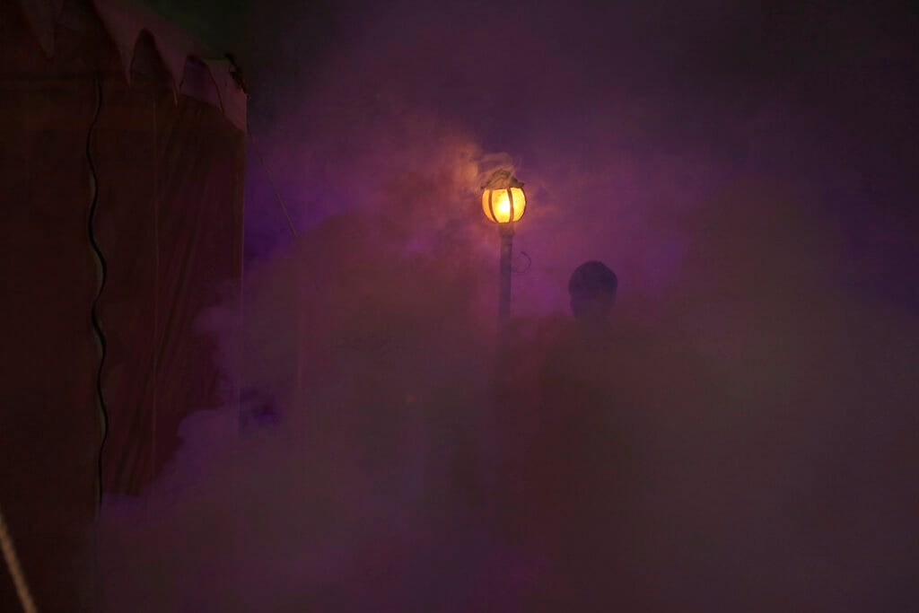 A man walks past smoke from fumigation to prevent mosquito-borne diseases at Sangam, the confluence of the Rivers Ganges, Yamuna and mythical Saraswati, during Kumbh festival in Prayagraj, Uttar Pradesh state, India, Friday, March 1, 2019. (AP Photo/ Rajesh Kumar Singh)