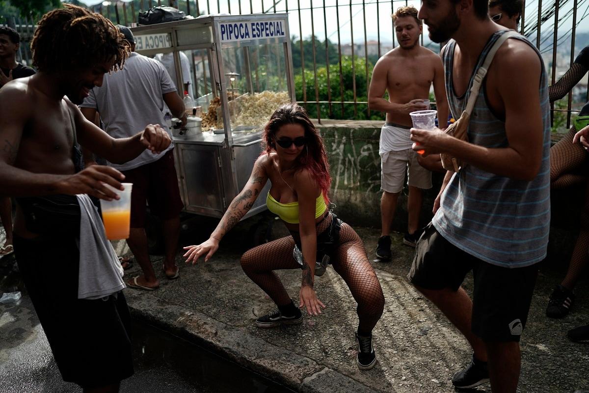 A reveller dances during Carmelita's street party. (AP Photo/Leo Correa)