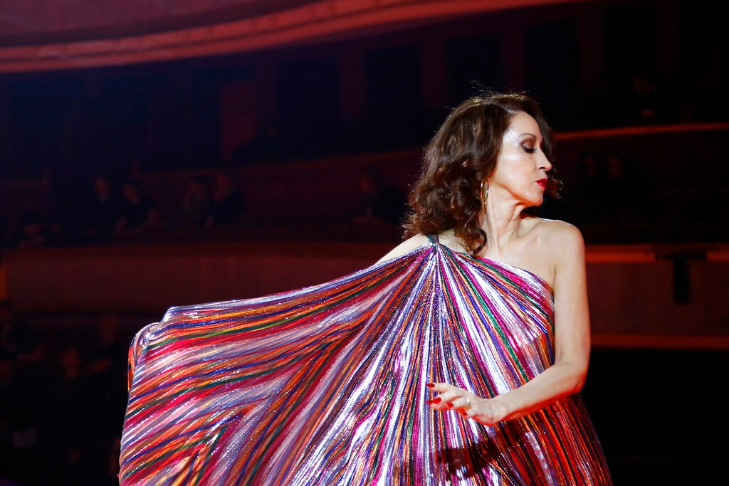 Model Pat Cleveland wears a creation as part of the Tommy Now ready to wear Fall-Winter 2019-2020 collection, that was presented in Paris, Saturday, March 2, 2019. (AP Photo/Michel Euler)
