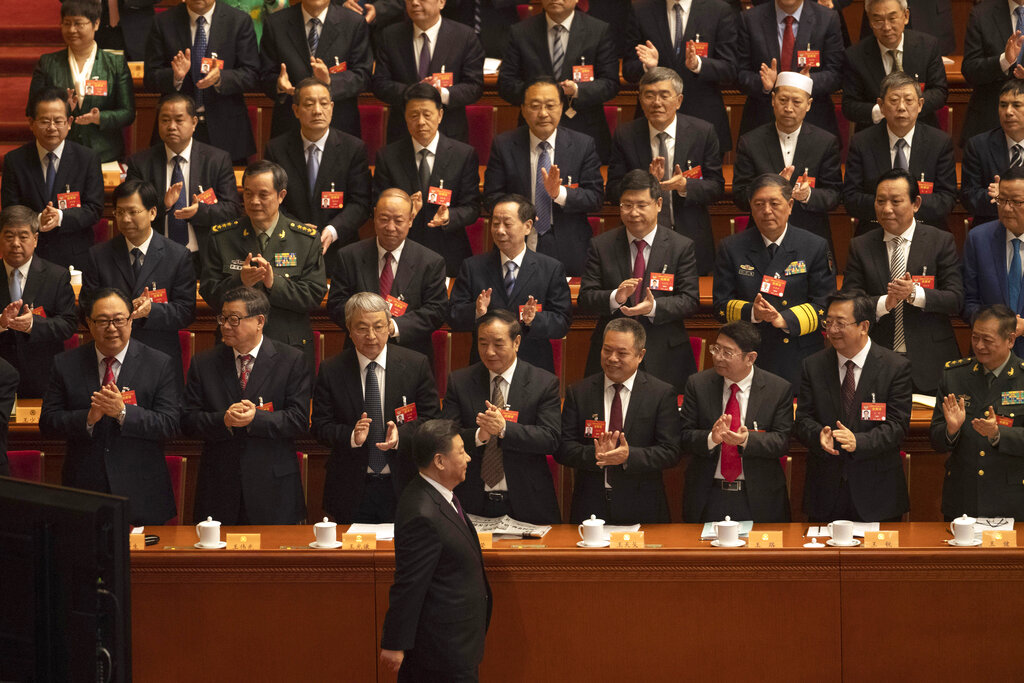 Chinese President Xi Jinping arrives for the opening session of the Chinese People's Political Consultative Conference in Beijing's Great Hall of the People, Sunday, March 3, 2019. (AP Photo/Ng Han Guan)