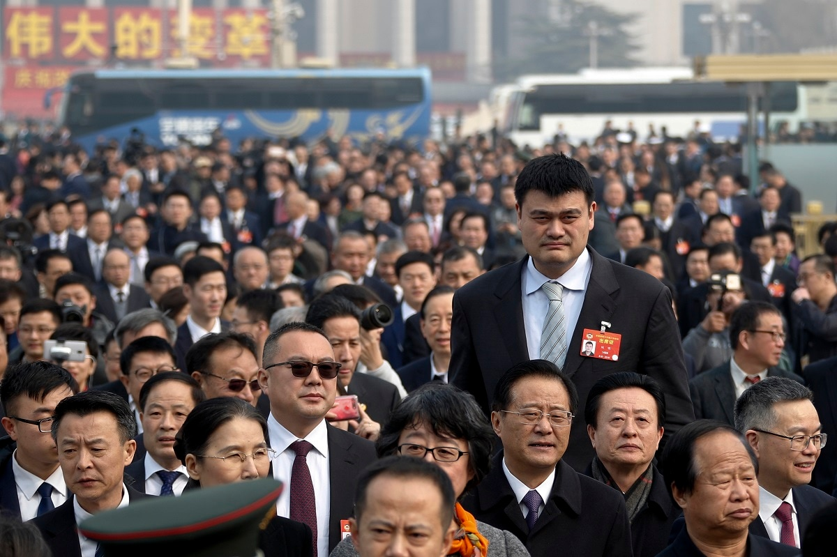 Former NBA basketball player Yao Ming, left, a delegate to the Chinese People's Political Consultative Conference (CPPCC), towers over other delegates as they arrive at the Great Hall of the People to attend the opening session of the CPPCC in Beijing. (AP Photo/Andy Wong, File)