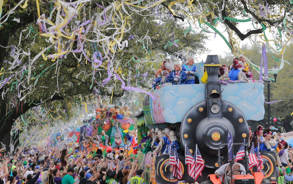 The Krewe of Thoth rolls along the Uptown route in New Orleans, La. Sunday, March 3, 2019. Founded in 1947, the Krewe of Thoth is named for the Egyptian Patron of Wisdom and Inventor of Science, Art and Letters. (David Grunfeld/The Times-Picayune via AP)