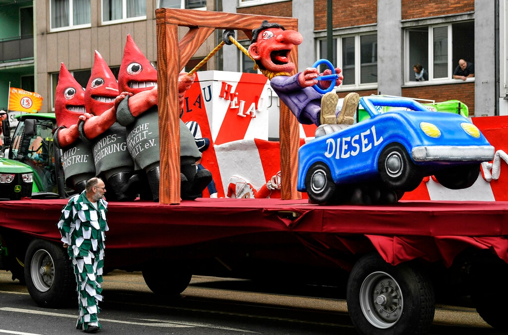 A carnival float depicts the Diesel Crisis for German car drivers prior to the traditional carnival parade in Duesseldorf, Germany, on Monday, March 4, 2019. (AP Photo/Martin Meissner)