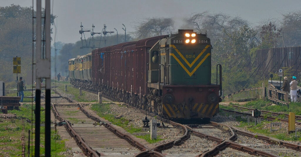 The Samjhauta Express train from Pakistan arrives in Atari, India, Monday, March 4, 2019. A Pakistani railway official said the key train service with neighboring India has resumed in another sign of easing tensions between the two nuclear-armed rivals since a major escalation last week over Kashmir region. (AP Photo/Prabhjot Gill)