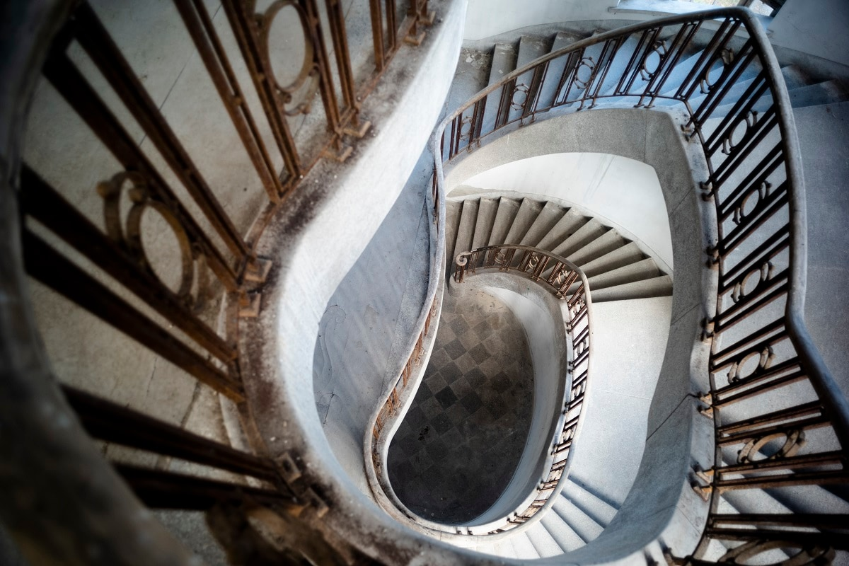 This photo shows the staircase inside the abandoned