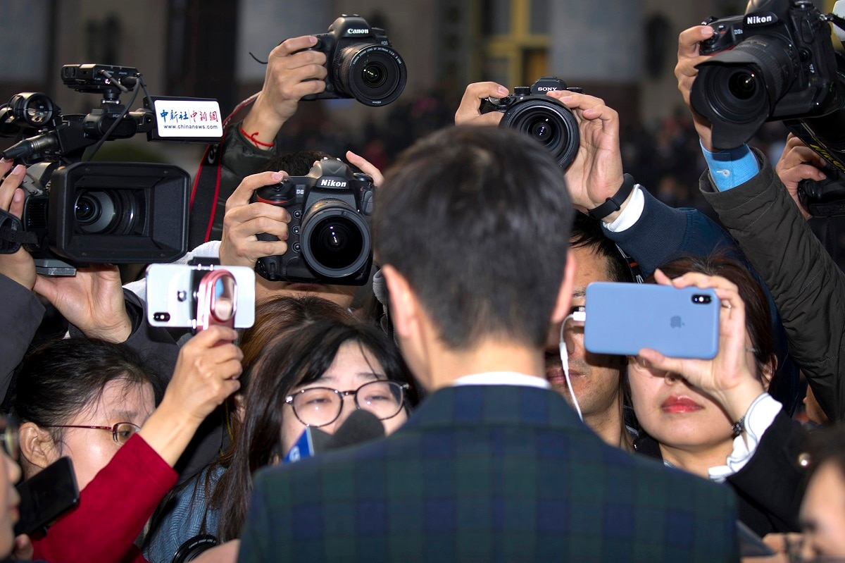 Journalists interview a delegate before the opening session of the Chinese People's Political Consultative Conference (CPPCC) at the Great Hall of the People in Beijing.  (AP Photo/Mark Schiefelbein)