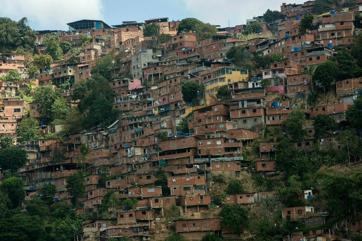 A portion of the Petare shantytown, one of Latin America's largest slums, in Caracas, Venezuela. Some 400,000 people live crowded into the thousands of brightly coloured cinderblock homes that blanket the Caracas hillsides as far as the eye can see. (AP Photo/Rodrigo Abd)
