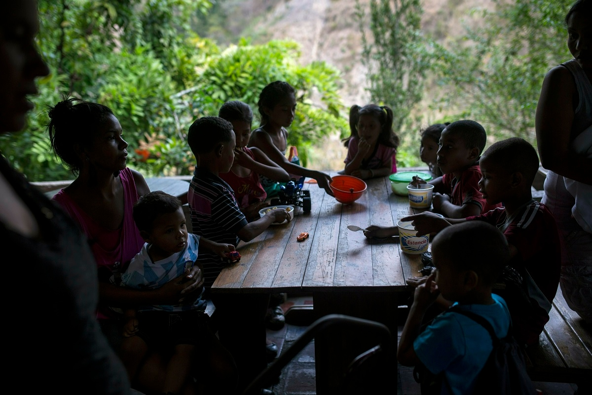 Children eat in a soup kitchen where they scoop spoonfuls of rice and scrambled eggs in what could be their only meal of the day, in the Petare slum, in Caracas, Venezuela. Part of the tragedy of daily life in socialist Venezuela can be glimpsed in this small volunteer soup kitchen in the heart of one of Latin America's biggest slums, which helps dozens of children as well as unemployed mothers who can no longer feed them. (AP Photo/Rodrigo Abd)