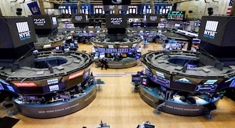 FILE - In this Oct. 18, 2017, file photo, traders work on the floor of the New York Stock Exchange. The bull market in stocks started with the U.S. still reeling from the Great Recession in March 2009. The bull turns 10 this weekend, having survived threats such as a debt crisis in Europe (2011), a slowdown in the Chinese economy (2015-2016), and fears of inflation and rising interest rates in the U.S. (AP Photo/Richard Drew, File)