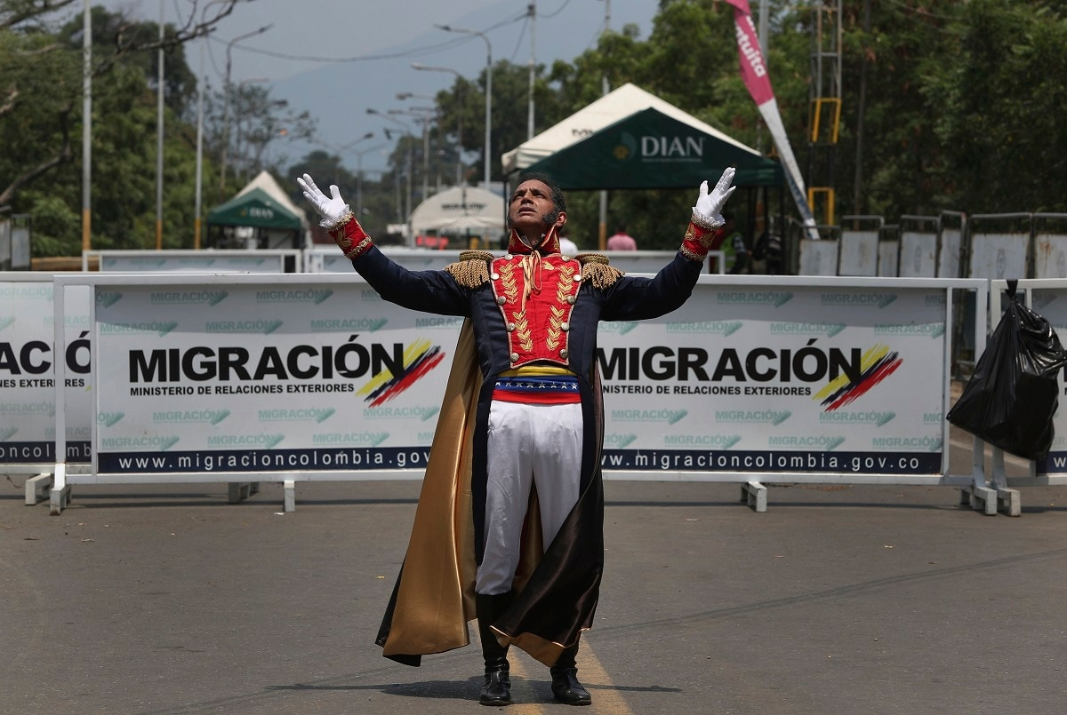 A man dressed as Venezuelan independence hero Simon Bolivar gestures on the Francisco de Paula Santander International Bridge, which Venezuelan authorities have closed down, near Cucuta, Colombia. Last weekend, opposition leader Juan Guaido coordinated a failed effort to bring aid from Colombia and Brazil into Venezuela, where security forces loyal to President Nicolas Maduro blocked the supplies at its border bridges, with Maduro describing Guaido's gambit as part of a US-backed plot to overthrow him. (AP Photo/Martin Mejia)
