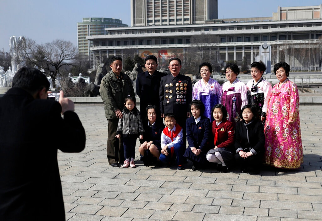 A North Korean family has their photo taken as they mark the International Women's Day in Pyongyang, North Korea, Friday, March 8, 2019. (AP Photo/Dita Alangkara)