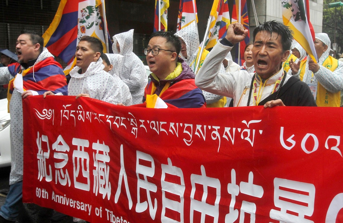 Tibetans living in Taiwan and their supporters shout slogans. (AP Photo/Chiang Ying-ying)