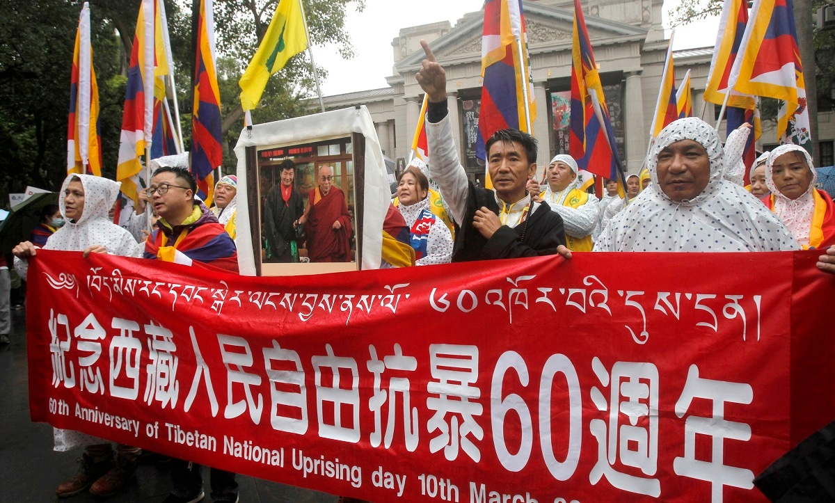 Tibetans living in Taiwan and their supporters shout slogans during a rally in Taipei. (AP Photo/Chiang Ying-ying)