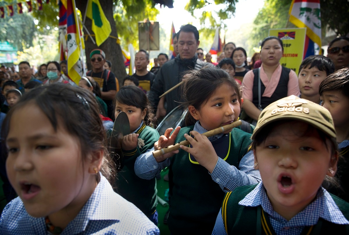 Tibetan school children sing their national anthem at the end of a march to mark the 60th anniversary of the March 10, 1959 Tibetan Uprising Day in New Delhi. (AP Photo/Manish Swarup)