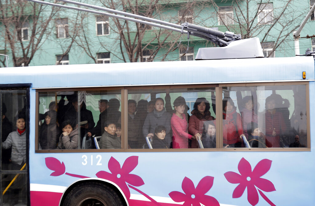 North Koreans ride on a trolley bus, a common mode of transportation for those living in the capital city, in Pyongyang, North Korea, Monday, March 11, 2019. (AP Photo/Dita Alangkara)